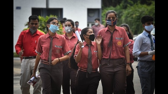 Students of class 12 exit after appearing for CBSE's Board Exam, September 22, 2020 (Sanchit Khanna/HT PHOTO)
