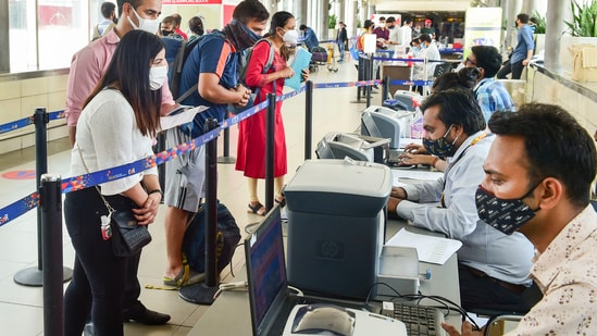 Air travellers get themselves registered for Covid-19 tests at the T-3 terminal of Indira Gandhi International Airport in New Delhi(PTI)