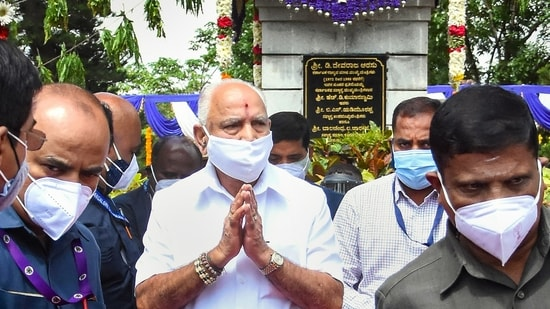 Karnataka chief minister B S Yediyurappa greets people after he pays respect to former CM D Devaraj Urs on his death anniversary in Bengaluru. (PTI Photo)