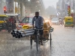 A man rides a cart during heavy rainfall on Friday. (ANI Photo)