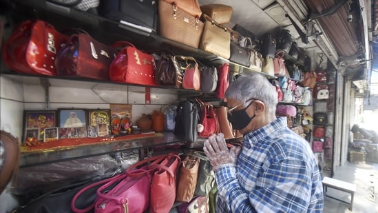 A shopkeeper was seen offering prayers as he reopened his shop at the Karolbagh market.(PTI)