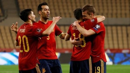 Spain's Dani Olmo celebrates scoring their first goal with Jordi Alba, Pedri and Sergio Busquets.(REUTERS)