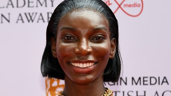 Michaela Coel poses for photographers upon arrival for the British Academy Television Awards in London, Sunday, June 6, 2021.(AP)