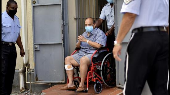 Mehul Choksi exits in a wheelchair the magistrate's court in Roseau, Dominica, Friday, June 4. (AP)