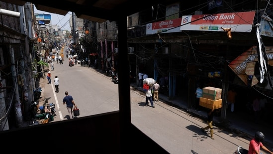 Traders flocked to market complexes in the early hours of the day to resume work. Some were also seen delivering fresh stock of articles to the shops on its first day of opening after the lockdown.(PTI)