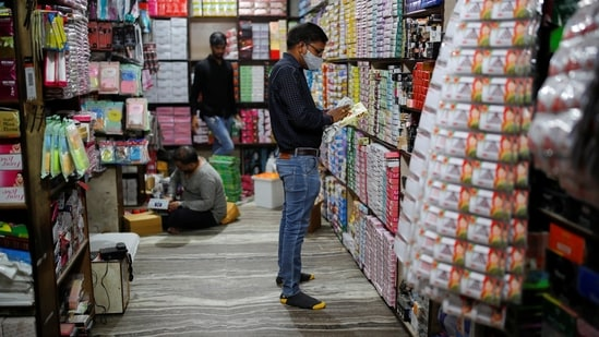 Shops reopened at Karolbagh market on an odd-even basis after further ease in the COVID-19 lockdown.(PTI)