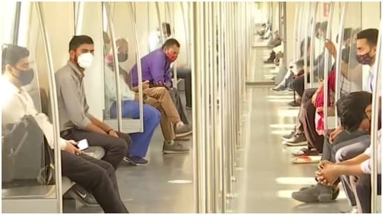 On the first day of the unlocking process from the COVID-19 induced lockdown in the national capital, passengers were seen commuting through Delhi Metro which has resumed services.(ANI)
