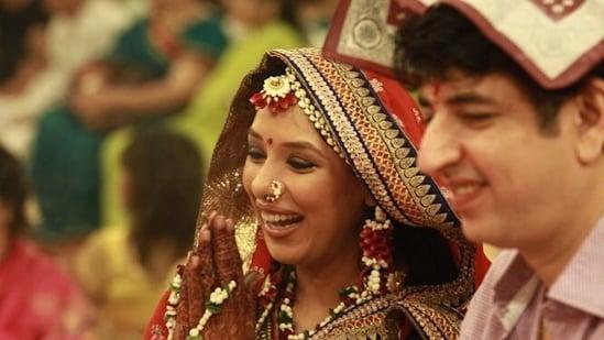 Rupali Ganguly with her husband Ashwin K Verma at her godhbharai ceremony.
