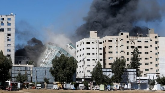 The airstrike came during an 11-day war between Israel and Gaza's ruling Hamas militant group. In picture - Gaza tower housing AP collapses after missile strike.(Reuters)