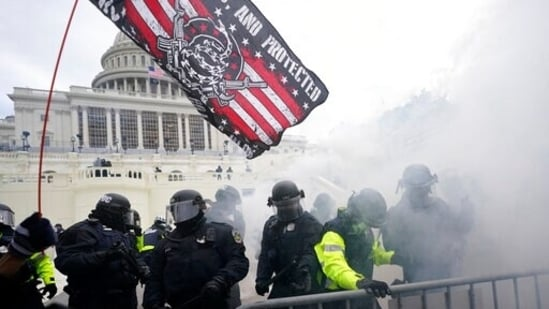 US Capitol Police officers hold off rioters loyal to President Donald Trump at the Capitol in Washington.(AP / File)