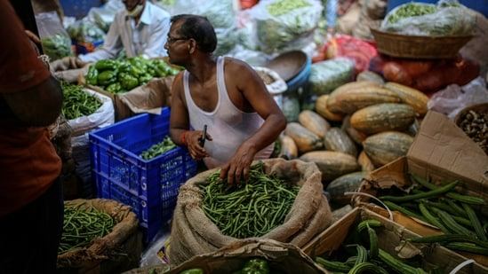 A wholesale vegetable market in the Dadar area of Mumbai, India, on Wednesday, May 26, 2021. India is preparing a stimulus package for sectors worst affected by a deadly coronavirus wave, aiming to support an economy struggling with a slew of localized lockdowns, people familiar with the matter said. The finance ministry is working on proposals to bolster the tourism, aviation and hospitality industries, along with small and medium-sized companies. Photographer: Dhiraj Singh/Bloomberg(Bloomberg)