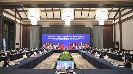 In this photo released by Xinhua News Agency, an Asean foreign ministers' meeting with Chinese state councillor and foreign minister Wang Yi is underway in Chongqing, China. (AP)
