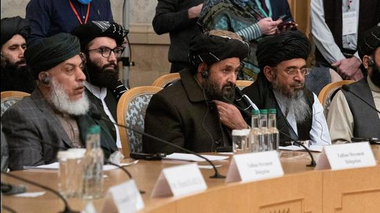 Mullah Abdul Ghani Baradar, the Taliban's deputy leader and negotiator, and other delegation members attend the Afghan peace conference in Moscow in March 2021 (REUTERS)