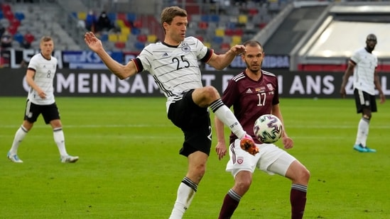 Germany's Thomas Mueller controls the ball during the international friendly.(AP)