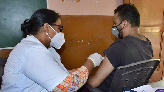 A medic administers a Covid vaccine dose to a man in Ludhiana on Tuesday. (Harsimar Pal Singh/HT)