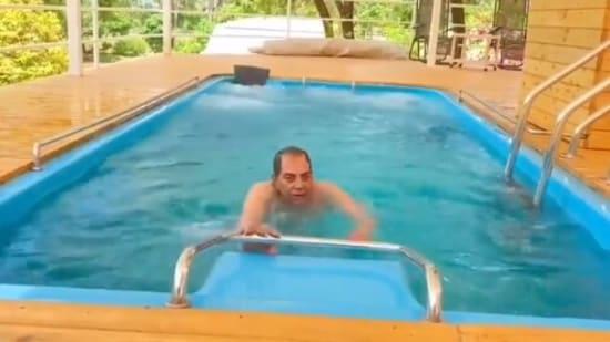 Dharmendra in his farmhouse swimming pool.