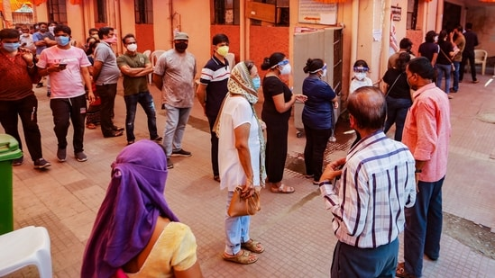 People wait to receive Covid-19 vaccine doses at a vaccination centre in Nagpur(PTI Photo)