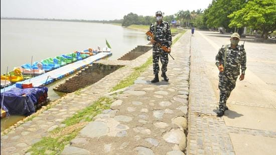 CRPF personnel patrolling Sukhna Lake in Chandigarh on Tuesday. The lake will be reopened for public from Wednesday. (Keshav Singh/HT)