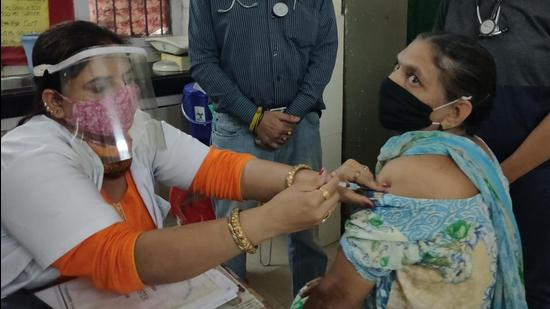 A woman getting vaccinated at the Sector-28 dispensary in Chandigarh on Tuesday. (Keshav Singh/HT)