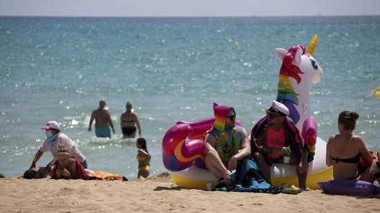 Spain opens borders to vaccinated tourists, cruise ships(Associated Press)