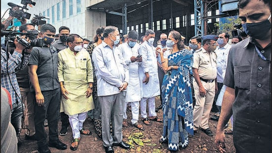 Maharashtra home minister Dilip Walse-Patil and Baramati Member of Parliament Supriya Sule on Tuesday visited SVS Aqua Technologies where a fire claimed 17 lives at Urawade, Pirangut in Pune on Monday. (PRATHAM GOKHALE/HT)