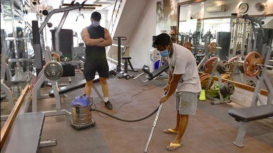 A gym owner supervising the sanitisation of his gym premises in BRS Nagar, Ludhiana, on Wednesday, (Harsimar Pal Singh/HT)