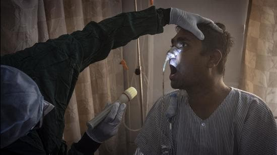 A doctor examines a patient of Mucormycosis at a dedicated ward at Noble hospital, Hadapsar, in Pune. (HT)