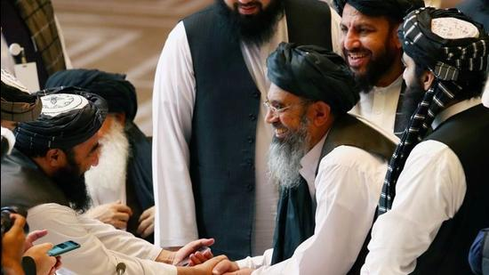 Taliban delegates shake hands during talks with the Afghan government in Doha, Qatar, on September 12, 2020. (File photo)