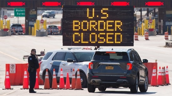 The easing of restrictions will hinge on Covid-19 case numbers and vaccinations, Health Minister Patty Hajdu said.. In picture - US Canada border in Lansdowne, Ontario closed during the early days of Covid-19 in 2020.(AFP)