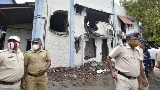 Police personnel at SVS Aqua Technologies, where a major broke out claiming 18 lives, in Mulshi taluka of Pune district.(PTI)