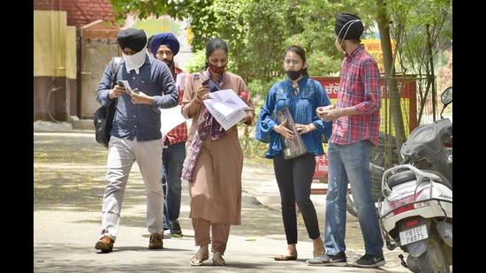 Candidates coming out from the examination centre at Government Senior Secondary School, Bharat Nagar, in Ludhiana on Wednesday. (Harsimar Pal Singh/HT)