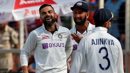 India's captain Virat Kohli celebrates with his teammates Cheteshwar Pujara and Ajinkya Rahane(REUTERS)