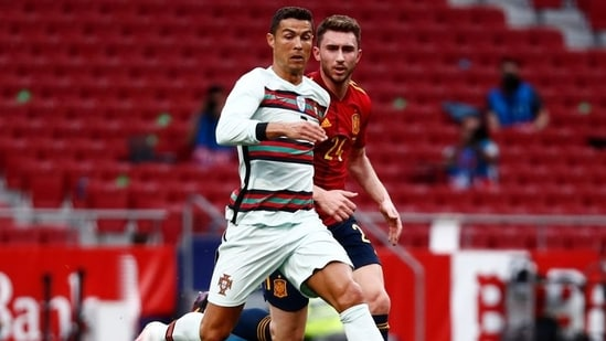 Portugal's Cristiano Ronaldo in action with Spain's Aymeric Laporte.(REUTERS)
