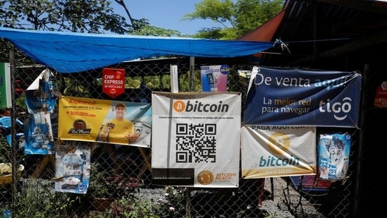 Bitcoin banners are seen outside of a small restaurant at El Zonte Beach in Chiltiupan, El Salvador.(REUTERS)