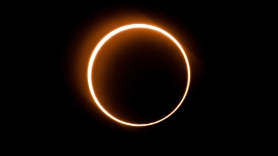 """The moon moves in front of the sun in a rare """"ring of fire"""" solar eclipse as seen from Tanjung Piai, Malaysia, on Dec. 26, 2019. (File Photo / AFP)"""