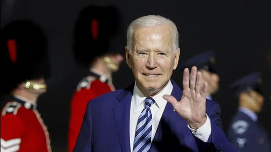 US President Joe Biden waves on his arrival on Air Force One at Cornwall Airport Newquay, in Newquay, England. (AP)