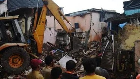 A residential structure collapsed over another in the New Collector Compound in Malad West in Mumbai on Wednesday night.