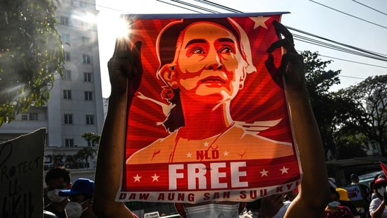 A protester holds up a poster featuring Aung San Suu Kyi during a demonstration against the military coup at in front of the Central Bank of Myanmar in Yangon.(AFP)