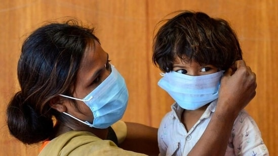Children aged between six to 11 years may wear a mask, but only the supervision of parents and the consulting doctor, the guidelines stated. (File Photo / PTI)