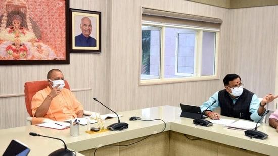 Uttar Pradesh chief minister Yogi Adityanath holding a meeting in Lucknow on Wednesday.(PTI Photo)