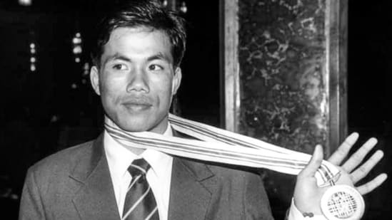 In this file photo circa 1998, boxer Dingko Singh shows his gold medal. (PTI)