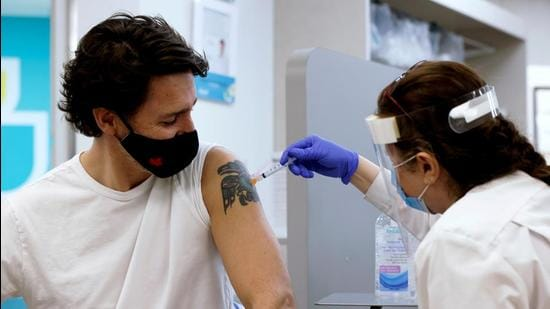 Canada's Prime Minister Justin Trudeau is inoculated with AstraZeneca's Covid-19 vaccine in Ottawa, Ontario on April 23, 2021. (REUTERS)