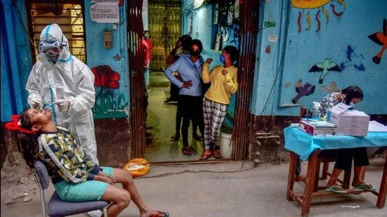 A health worker collects sample from a girl for Covid-19 test, at a Children's Home in New Delhi. (File photo)