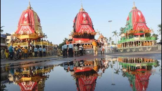 At least 88 people including 40 carpenters, 31 bhoi servitors, 13 blacksmiths and four temple officials are working since Akshaya Tritiya (May 15) to make the 3 chariots. (HT FILE PHOTO.)