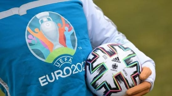 UEFA Euro 2020 mascot Skillzy poses for a photo with the official match ball at Olympiapark in Munich, Germany.(REUTERS)