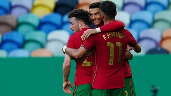 Cristiano Ronaldo of Portugal celebrates with teammates after scoring a goal. (Getty Images)