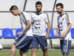 Angel Di Maria (L) controls a mini ball next to Lionel Messi (R) and Sergio Aguero. (Getty Images)