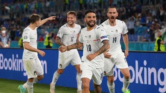Italy's Lorenzo Insigne celebrates scoring their third goal with teammates.(Pool via REUTERS)