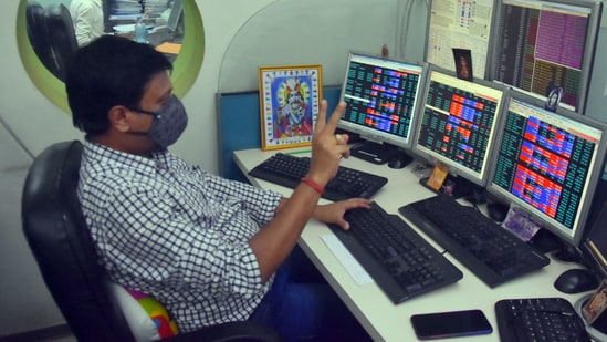 Shareholders and brokers react as Sensex and Nifty reach record highs in Kolkata. (ANI)