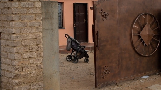 A pram stands outside the home of Gosiame Thamara Sithole in Tembisa, near Johannesburg, on June 10, 2021. (AP Photo)